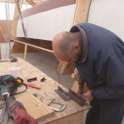 Steve Peine works on creating holders for the rollers.