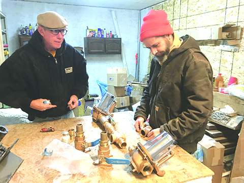 Bill and Hugh assemble the bronze raw water strainers.