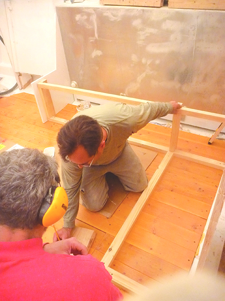 David Leanza and Capt Hugh discuss layout of the salon settee.