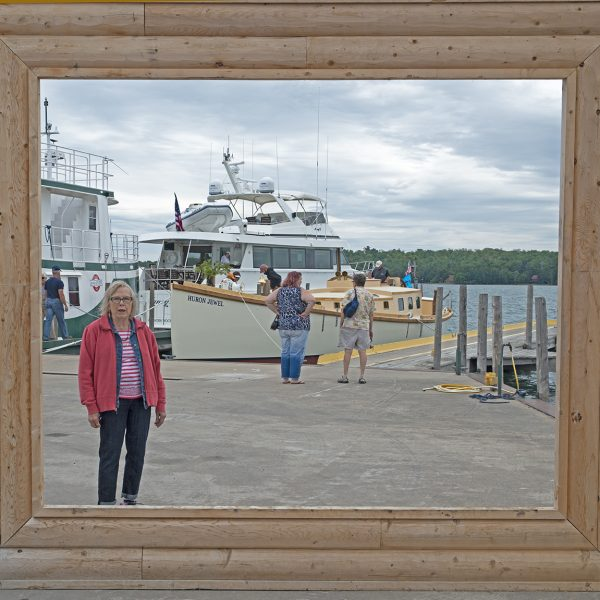 "Attendees enjoyed getting their picture taken with the schooner framed by the schooner-sized picture frame. (Photo by Richard ""Dock"" Borth)"