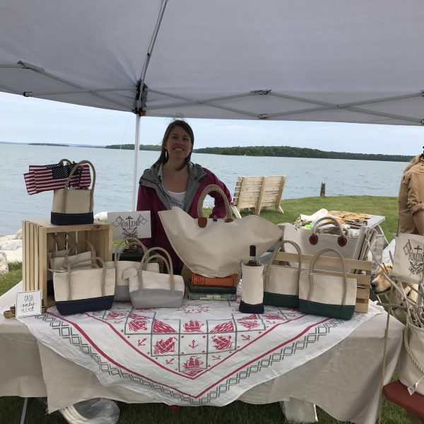 """Iron Jenny"" Grant, one of the many vendors, shows off her canvas bag wares."
