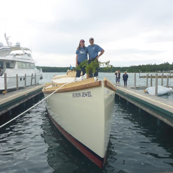 Julie and Capt Hugh stand aboard Schooner Huron Jewel floating for the first time.
